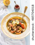 soup with trout and seafood | Shutterstock . vector #485704018
