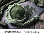 spirulina powder on a wooden... | Shutterstock . vector #485713312
