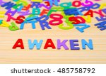 Small photo of Colorful alphabet with word awaken