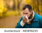 ailing man in the autumn outdoor | Shutterstock . vector #485898235