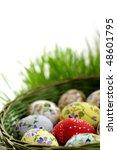 Easter egg in wicker basket - stock photo