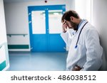sad doctor leaning against the... | Shutterstock . vector #486038512