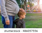 pregnant mother and her son... | Shutterstock . vector #486057556