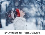 happy girl catches snowflakes... | Shutterstock . vector #486068296