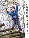 kid in adventure park walking... | Shutterstock . vector #486098926