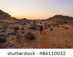 tourist walking in the namib... | Shutterstock . vector #486110032