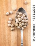 chickpeas in silver spoon on a... | Shutterstock . vector #486112396