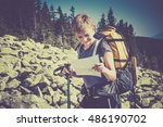 young female hiker in the... | Shutterstock . vector #486190702