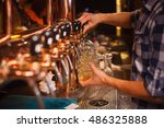 the bartender pours a beer at... | Shutterstock . vector #486325888