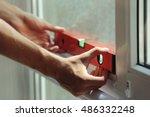 construction worker installing... | Shutterstock . vector #486332248