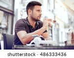 young businessman sitting in a... | Shutterstock . vector #486333436