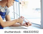 construction worker installing... | Shutterstock . vector #486333502