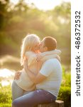 young couple in love on park... | Shutterstock . vector #486372532