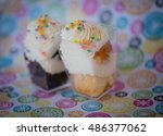 Two Colorful Cupcakes With...