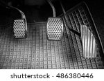 Small photo of Brake and accelerator inside the car with dust.