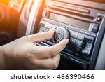 Woman Turning Button Of Radio...