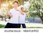 people practicing thai chi in... | Shutterstock . vector #486416902