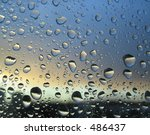 rain drops on the window, sunset in background, stormy clouds behind #2 - stock photo