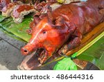 roast pig head under sun... | Shutterstock . vector #486444316