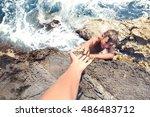 Boy In Danger Extends His Hand...