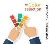 man holding a palette samples... | Shutterstock .eps vector #486498565