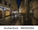 people in city walking at night  | Shutterstock . vector #486502066