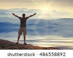 man with raised hands standing... | Shutterstock . vector #486558892