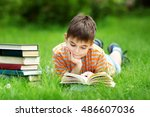 seven years old child reading a ... | Shutterstock . vector #486607036