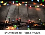 christmas lights on dark wooden ... | Shutterstock . vector #486679306