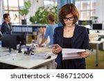 businesswoman reading a... | Shutterstock . vector #486712006