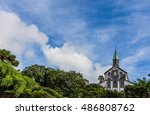 oura catholic church  and blue... | Shutterstock . vector #486808762