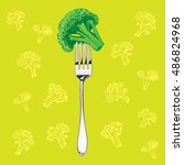 green broccoli on a metal fork... | Shutterstock .eps vector #486824968