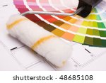 Color samples for selection and a a painter´s roll with house plan on background - stock photo