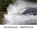 driving cars on a flooded road... | Shutterstock . vector #486929116