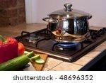 Saucepan on a gas torch - stock photo
