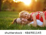 mother and daughter lying on... | Shutterstock . vector #486981145