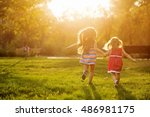 two sisters running on the lawn ...   Shutterstock . vector #486981175