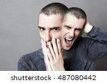 Small photo of concept of madness, schizophrenia, mad bipolar behavior and anxiety with two-headed disturbed man screaming or expressing fear, grey background