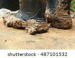 muddy black boots.