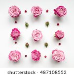 Stock photo decorative pattern with pink bright roses buds and berries on white background flat lay top view 487108552