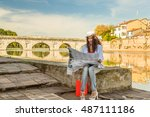 rimini  italy  woman consulting ... | Shutterstock . vector #487111186