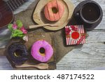 donuts and coffee for a brake... | Shutterstock . vector #487174522