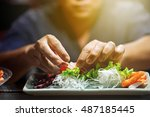 hand of chef making sushi on... | Shutterstock . vector #487185445