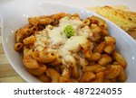 baked mac on a white plate | Shutterstock . vector #487224055