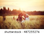 owner and dog labrador in field ... | Shutterstock . vector #487255276