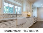 Stock photo custom kitchen cabinets custom tile white and clean 487408045