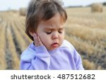 little girl with ear pain... | Shutterstock . vector #487512682