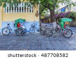 cyclo on a street of hoi an old ... | Shutterstock . vector #487708582