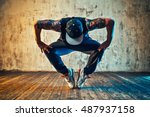 young man break dancing on wall ... | Shutterstock . vector #487937158