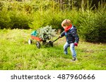boy pulling a cart to carry the ... | Shutterstock . vector #487960666